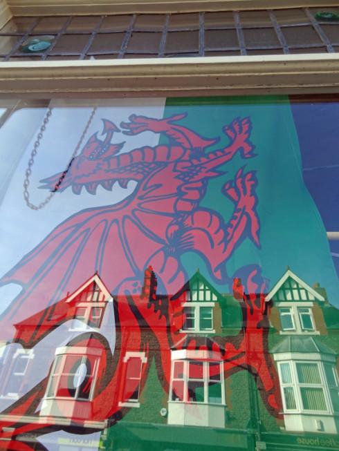 Draig Goch / Red Dragon flag in Hall's Of Llandaff window
